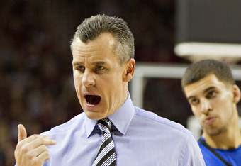 FAYETTEVILLE, AR - FEBRUARY 18:    Head Coach Billy Donovan of the Florida Gators yells at his players on the bench during a game against the Arkansas Razorbacks at Bud Walton Arena on February 18, 2012 in Fayetteville, Arkansas.  The Gators defeated the