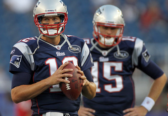 FOXBORO, MA - SEPTEMBER 1:   Tom Brady #12 of the New England Patriots and  Ryan Mallett #15 of the New England Patriots complete a drill before a game with the New York Giants at Gillette Stadium on September 1, 2011 in Foxboro, Massachusetts. (Photo by