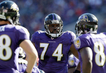 BALTIMORE, MD - OCTOBER 30:  Michael Oher #74 of the Baltimore Ravens waits in the huddle against the Arizona Cardinals at M&T Bank Stadium on October 30, 2011 in Baltimore, Maryland. The Baltimore won 30-27.  (Photo by Rob Carr/Getty Images)