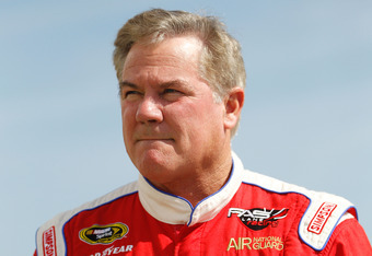 DAYTONA BEACH, FL - FEBRUARY 24:  Terry Labonte, driver of the #32 C&J Energy Ford, walks in the garage area during practice for the NASCAR Sprint Cup Series Daytona 500 at Daytona International Speedway on February 24, 2012 in Daytona Beach, Florida.  (P