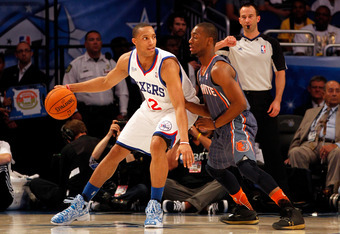 ORLANDO, FL - FEBRUARY 24:  Evan Turner #12 of the Philadelphia 76ers and Team Chuck posts up against Kemba Walker #1 of the Charlotte Bobcats and Team Shaq during the BBVA Rising Stars Challenge part of the 2012 NBA All-Star Weekend at Amway Center on Fe