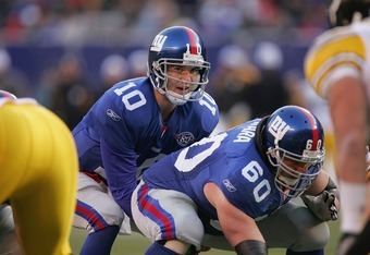 EAST RUTHERFORD, NJ - DECEMBER 18:  Eli Manning #10 of the New York Giants lines up under center Shaun O'Hara #60 during the game against the Pittsburgh Steelers at Giants Stadium on December 18, 2004 in East Rutherford, New Jersey. The Steelers won 33-30