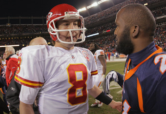 DENVER, CO - JANUARY 01:  Quarterback Kyle Orton #8 of the Kansas City Chiefs and cornerback Champ Bailey #24 of the Denver Broncos talk after the game at Sports Authority Field at Mile High on January 1, 2012 in Denver, Colorado. The Chiefs defeated the