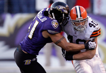 BALTIMORE, MD - DECEMBER 24:  Brendon Ayanbadejo #51 of the Baltimore Ravens tackles  Peyton Hillis #40 of the Cleveland Browns short of a first down during the second half of the Ravens 20-14 win at M&T Bank Stadium on December 24, 2011 in Baltimore, Mar
