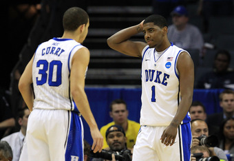 CHARLOTTE, NC - MARCH 20:  Kyrie Irving #1 looks over at teammate Seth Curry #30 of the Duke Blue Devils while taking on the Michigan Wolverines during the third round of the 2011 NCAA men's basketball tournament at Time Warner Cable Arena on March 20, 20