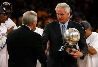 Lakers GM Mitch Kupchak receives congratulations from Jerry West after the Lakers advanced to the 2008 finals by beating San Antonio. Photo by Jeff Gross/Getty Images.