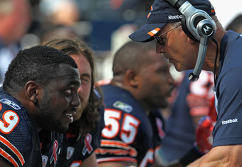 CHICAGO, IL - SEPTEMBER 11: Henry Melton #69 of the Chicago Bears listens to defensive coordinator Rod Marinelli on the bench during a game against the Atlanta Falcons at Soldier Field on September 11, 2011 in Chicago, Illinois. The Bears defeated the Fal