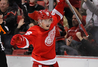 DETROIT, MI - FEBRUARY 14:  Jiri Hudler #26 of the Detroit Red Wings celebrates his third period goal while playing the Dallas Stars at Joe Louis Arena on February 14, 2012 in Detroit, Michigan. The win set a NHL record for the most consecutive home victo