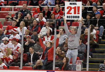 DETROIT, MI - FEBRUARY 14: A fan holds up a sign congratulating the Detroit Red Wings on their NHL record breaking 21st consecutive home victory by beating the Dallas Stars 3-1 at Joe Louis Arena on February 14, 2012 in Detroit, Michigan. (Photo by Gregor