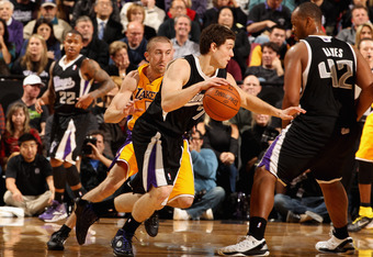 SACRAMENTO, CA - DECEMBER 26:  Jimmer Fredette #7 of the Sacramento Kings in action against the Los Angeles Lakers at Power Balance Pavilion on December 26, 2011 in Sacramento, California.  NOTE TO USER: User expressly acknowledges and agrees that, by dow
