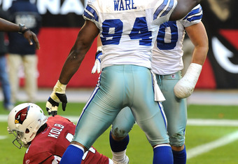 GLENDALE, AZ - DECEMBER 04:  DeMarcus Ware #94 and teammate Sean Lee #50 of the Dallas Cowboys celebrate a sack against the Arizona Cardinals at University of Phoenix Stadium on December 4, 2011 in Glendale, Arizona.  (Photo by Norm Hall/Getty Images)