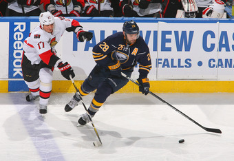 BUFFALO, NY - DECEMBER 31: Paul Gaustad #28 of the Buffalo Sabresskates against Filip Kuba #17 of the Ottawa Senators at First Niagara Center on December 31, 2011 in Buffalo, New York. (Photo by Rick Stewart/Getty Images)