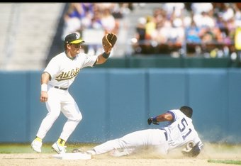 Mike Gallego (left) with Oakland in a 1991 game against New York. The following year, Gallego signed a free agent contract with the Yankees.