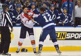 Tampa Bay Lightning's Ryan Malone (right) fights Florida Panthers Erik Gudbranson