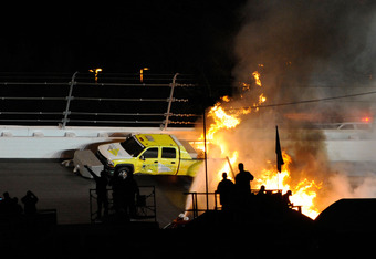 DAYTONA BEACH, FL - FEBRUARY 27:  Safety workers try to extinguish a fire from a jet dryer after being hit by Juan Pablo Montoya, driver of the #42 Target Chevrolet, under caution during the NASCAR Sprint Cup Series Daytona 500 at Daytona International Sp