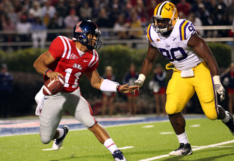 OXFORD, MS - NOVEMBER 19: Barry Brunetti #11 of the Ole Miss Rebels scrambles with the ball against Michael Brockers #90 of the LSU Tigers on November 19, 2011 at Vaught-Hemingway Stadium in Oxford, Mississippi.  (Photo by Joe Murphy/Getty Images)