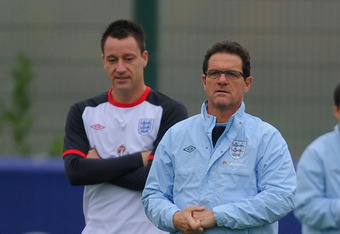 LONDON COLNEY, ENGLAND - NOVEMBER 14:  England manager Fabio Capello looks on with John Terry during the England training session on November 14, 2011 in London Colney, England.  (Photo by Michael Regan/Getty Images)