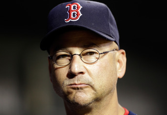 BALTIMORE, MD - SEPTEMBER 26: Manager Terry Francona looks on from the dugout during the second inning of the Red Sox game against the Baltimore Orioles at Oriole Park at Camden Yards on September 26, 2011 in Baltimore, Maryland.  (Photo by Rob Carr/Getty