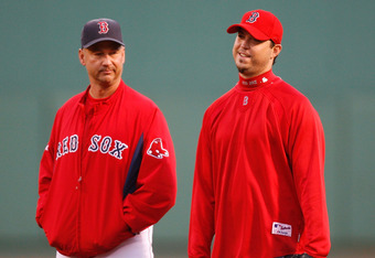 BOSTON - OCTOBER 14:  Josh Beckett #19 of the Boston Red Sox stands with manager Terry Francona before game four of the American League Championship Series against the Tampa Bay Rays during the 2008 MLB playoffs at Fenway Park on October 14, 2008 in Bosto