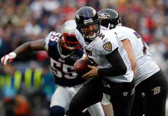 FOXBORO, MA - JANUARY 22:  Joe Flacco #5 of the Baltimore Ravens in action against the New England Patriots during their AFC Championship Game at Gillette Stadium on January 22, 2012 in Foxboro, Massachusetts.  (Photo by Rob Carr/Getty Images)