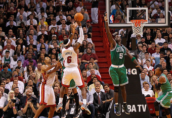 MIAMI, FL - DECEMBER 27: LeBron James #6 of the Miami Heat shoots over Kevin Garnett #5 of the Boston Celtics during a game  at American Airlines Arena on December 27, 2011 in Miami, Florida. NOTE TO USER: User expressly acknowledges and agrees that, by d