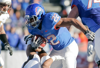 BOISE, ID - NOVEMBER 26: Doug Martin #22 of the Boise State Broncos runs the ball against the Wyoming Cowboys at Bronco Stadium on November 26, 2011 in Boise, Idaho.  (Photo by Otto Kitsinger III/Getty Images)