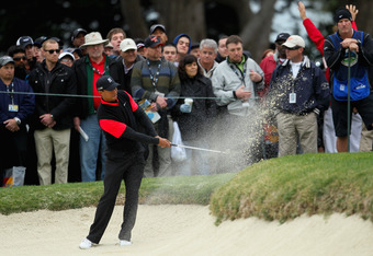 PEBBLE BEACH, CA - FEBRUARY 12: Tiger Woods hits from a greenside bunker on the 12th hole during the final round of the AT&T Pebble Beach National Pro-Am at Pebble Beach Golf Links on February 12, 2012 in Pebble Beach, California.  (Photo by Jeff Gross/Ge
