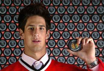 Simon Danis-Pepin is a huge defenseman, but hasn't justified his draft position while in the 'Hawks organization.