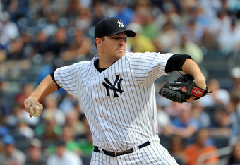 NEW YORK, NY - AUGUST 13: Phil Hughes #65 of the New York Yankees throws a pitch in the top of the first inning against the Tampa Bay Rays at Yankee Stadium on August 13, 2011 in the Bronx borough of New York City. (Photo by Christopher Pasatieri/Getty Im