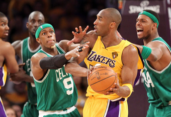 LOS ANGELES, CA - JUNE 17:  Kobe Bryant #24 of the Los Angeles Lakers is double-teammed by Rajon Rondo #9 and Paul Pierce #34 of the Boston Celtics in the third quarter of Game Seven of the 2010 NBA Finals at Staples Center on June 17, 2010 in Los Angeles