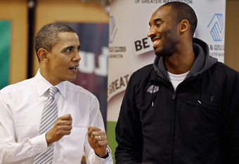 WASHINGTON, DC - DECEMBER 13:  (AFP OUT) U.S. President Barack Obama (L) talks with Kobe Bryant of the Los Angeles Lakers while filling care packages during a NBA Cares service event at the Boys and Girls Club at THEARC  December 13, 2010 in Washington, D