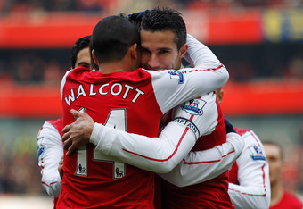 LONDON, ENGLAND - FEBRUARY 04:  Robin van Persie of Arsenal celebrates with teammate Theo Walcott after scoring the first goal during the Barclays Premier League match between Arsenal and Blackburn Rovers at Emirates Stadium on February 4, 2012 in London,