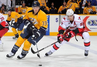 NASHVILLE, TN - JANUARY 07:  Brandon Sutter #16 of the Carolina Hurricanes skates against Colin Wilson #33 of the Nashville Predators at the Bridgestone Arena on January 7, 2012 in Nashville, Tennessee.  (Photo by Frederick Breedon/Getty Images)