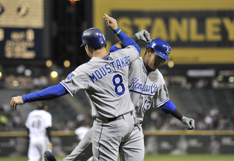 CHICAGO, IL - SEPTEMBER 23:  Salvador Perez #13 of the Kansas City Royals is greeted at home plate by teammate Mike Moustakas #8 after hitting a three-run home run during the fourth inning against the Chicago White Sox at U. S. Cellular Field on September