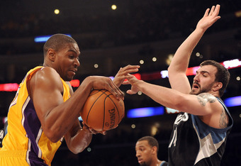LOS ANGELES, CA - FEBRUARY 29:  Andrew Bynum #17 of the Los Angeles Lakers grabs possession of the ball in front of Nikola Pekovic #14 of the Minnesota Timberwolves at Staples Center on February 29, 2012 in Los Angeles, California.  NOTE TO USER: User exp