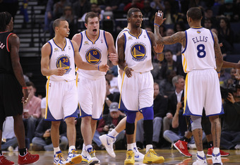OAKLAND, CA - FEBRUARY 15:  Stephen Curry #30, David Lee #10, Dorell Wright #1 and Monta Ellis #8 of the Golden State Warriors celebrate after a basket during their game against the Portland Trail Blazers at Oracle Arena on February 15, 2012 in Oakland, C