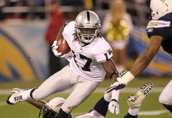SAN DIEGO, CA - NOVEMBER 10:  Wide receiver Denarius Moore #17 of the Oakland Raiders carries the ball agaisnt the San Diego Chargers at Qualcomm Stadium on November 10, 2011 in San Diego, California.  (Photo by Stephen Dunn/Getty Images)