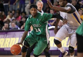 DeAndre Kane dribbles around the defense as the Marshall Thundering Herd take on the Pirates of East Carolina University. (Jonathan McKnight for the Herald Dispatch)