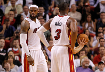 MIAMI, FL - FEBRUARY 21:  LeBron James #6 and Dwyane Wade #3 of the Miami Heat look on during a game against the Sacramento Kings at American Airlines Arena on February 21, 2012 in Miami, Florida. NOTE TO USER: User expressly acknowledges and agrees that,
