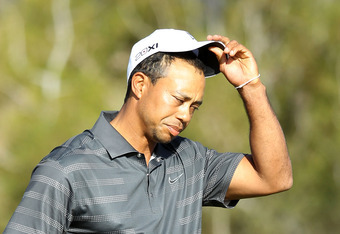 MARANA, AZ - FEBRUARY 23:  Tiger Woods reacts after losing his match to Nick Watney (not pictured) on the 18th hole during the second round of the World Golf Championships-Accenture Match Play Championship at the Ritz-Carlton Golf Club  on February 23, 20