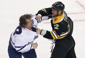 BOSTON, MA - OCTOBER 20:  Shawn Thornton #22 of the Boston Bruins and Colton Orr #28 of the Toronto Maple Leafs fight in the first period on October 20, 2011 at TD Garden in Boston, Massachusetts.  (Photo by Elsa/Getty Images)