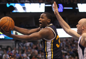DALLAS, TX - FEBRUARY 23:  Forward C.J. Miles #34 of the Utah Jazz takes a shot against Brian Cardinal #35 of the Dallas Mavericks at American Airlines Center on February 23, 2011 in Dallas, Texas.  NOTE TO USER: User expressly acknowledges and agrees tha
