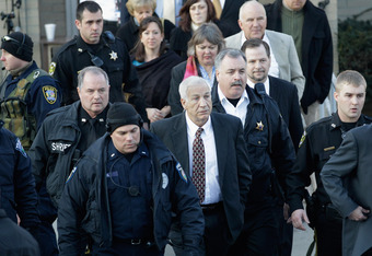 BELLEFONTE, PA - DECEMBER 13:  Former Penn State assistant football coach Jerry Sandusky (C) leaves the Centre County Courthouse on December 13, 2011 in Bellefonte, Pennsylvania. Sandusky attended a prelininary hearing on charges he sexual abused 10 boys.