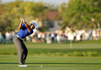 PALM BEACH GARDENS, FL - MARCH 02:  Tiger Woods hits his approach shot on the 11th hole during the second round of the Honda Classic at PGA National on March 2, 2012 in Palm Beach Gardens, Florida.  (Photo by Mike Ehrmann/Getty Images)
