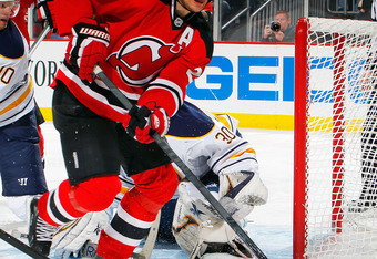NEWARK, NJ - JANUARY 24:  Patrik Elias #26 of the New Jersey Devils skates by the goal during an NHL hockey game against the Buffalo Sabres at Prudential Center on January 24, 2012 in Newark, New Jersey.  (Photo by Paul Bereswill/Getty Images)