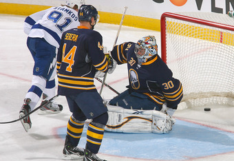 BUFFALO, NY - OCTOBER 25:Steven Stamkos #91 of the Tampa Bay Lightning watches his deflection go between the legs of Ryan Miller #30 of the Buffalo Sabres for Tampa Bay's third goal at First Niagara Center on October 25, 2011 in Buffalo, New York.  (Photo