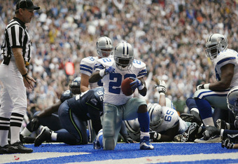 IRVING, TX - OCTOBER 27:   Running Back Emmitt Smith #22 of the Dallas Cowboys makes the touch down during the NFL game against the Seattle Seahawks at Texas Stadium on October 27, 2002 in Irving, Texas. The Seahawks defeated the Cowboys 17-14. (Photo by