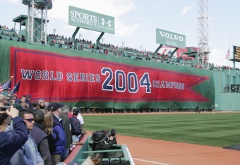 BOSTON - APRIL 11:  The Boston Red Sox display a 2004 World Series Championship banner during the pregame ceremony celebrating the Red Sox win in the World Series. The ceremony was held prior to the game against the New York Yankees at Fenway Park on Apri