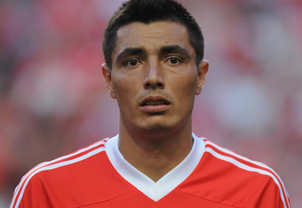 Benfica's Oscar Cardozo scored two goals in loss
