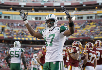 LANDOVER, MD - DECEMBER 04:  Plaxico Burress #17 of the New York Jets celebrates after the Jets scored a touchdown against the Washington Redskins during the second half at FedExField on December 4, 2011 in Landover, Maryland.  (Photo by Rob Carr/Getty Im